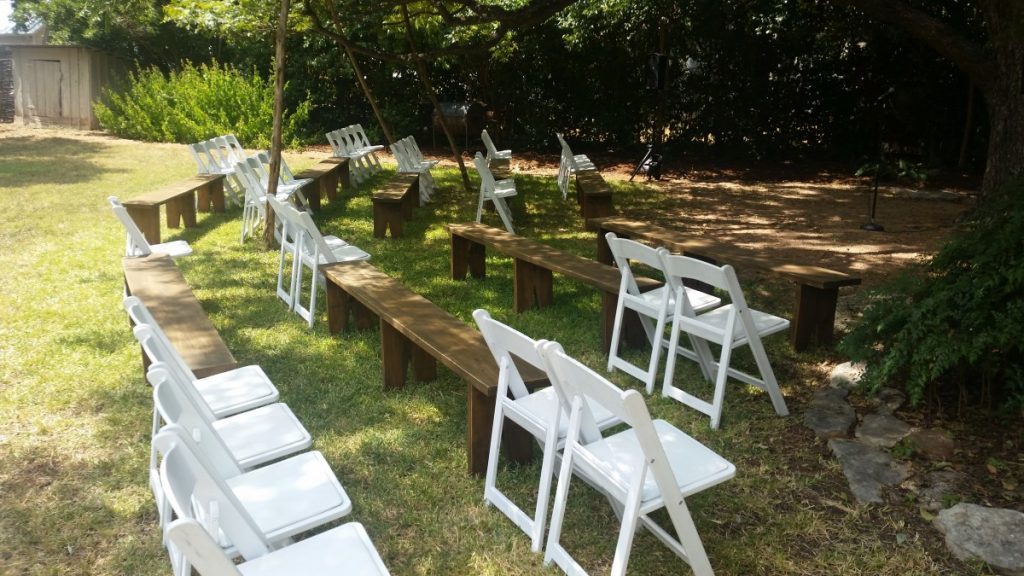 Benches with White Folding Chairs at Ceremony