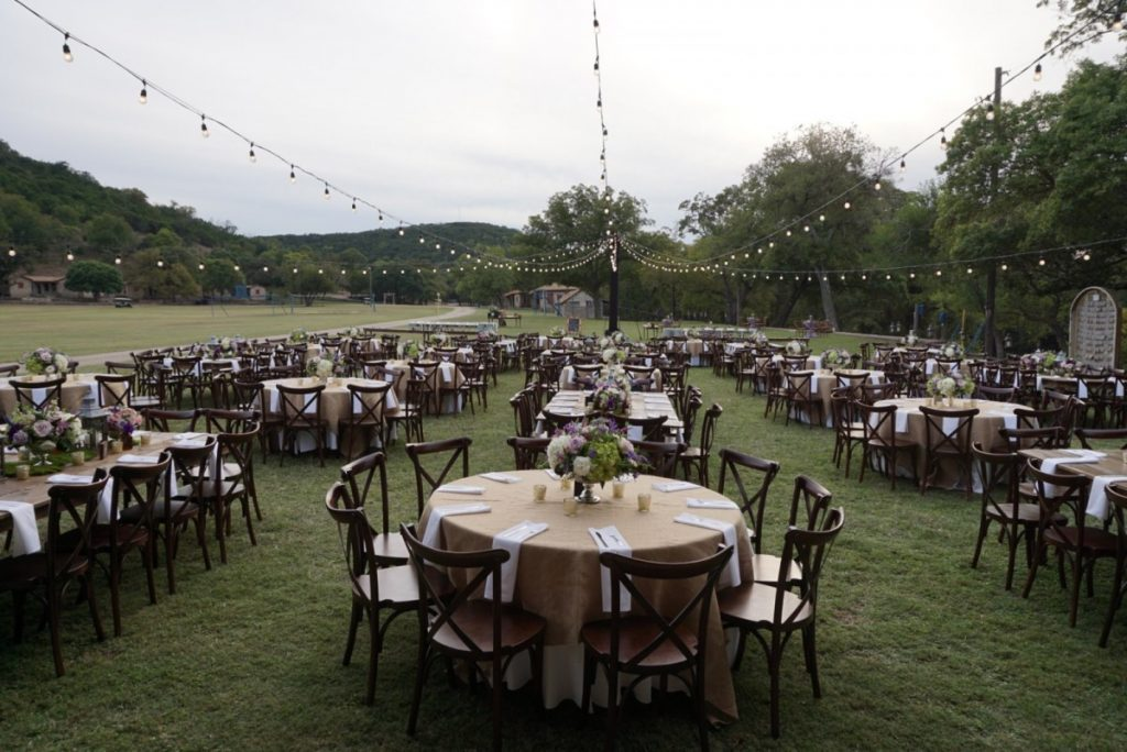 Outdoor Rustic Reception Featuring Crossback Chairs