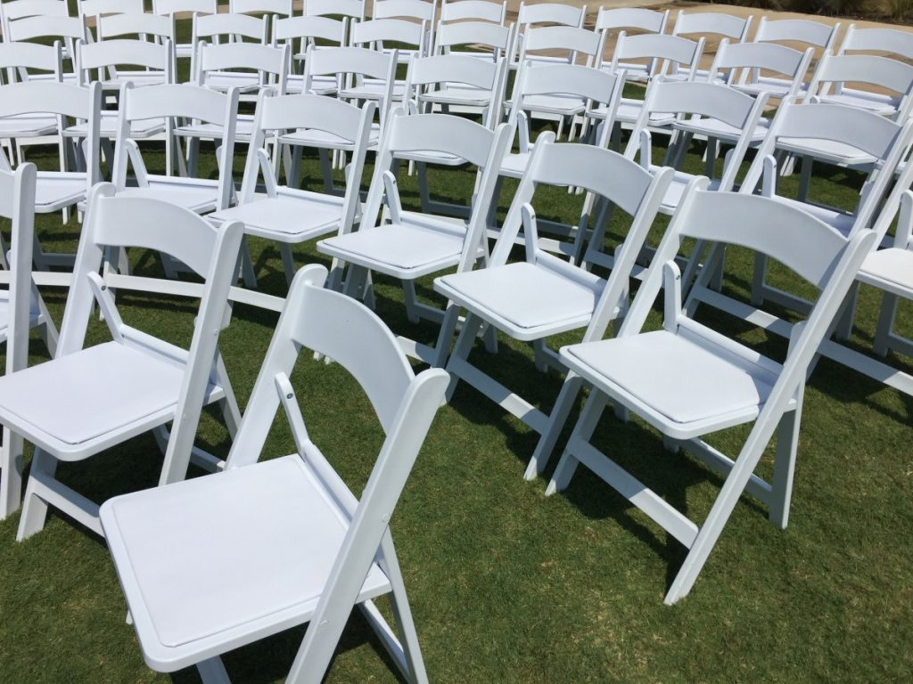 White Folding Chairs at Ceremony
