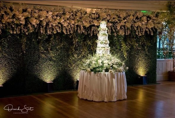 Lit Hedge Walls with Floral Attached by Florist