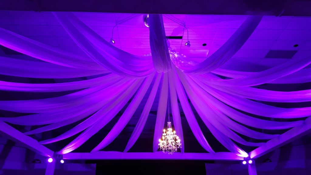 Lighted Ceiling Draping with Uplights & Chandelier