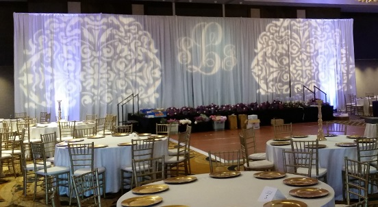 Wall Draping as Stage Backdrop with Custom Gobo Light Projection