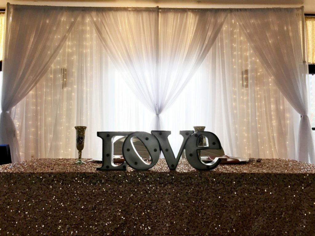Wall Draping with Lighted Curtain Behind Sweetheart Table