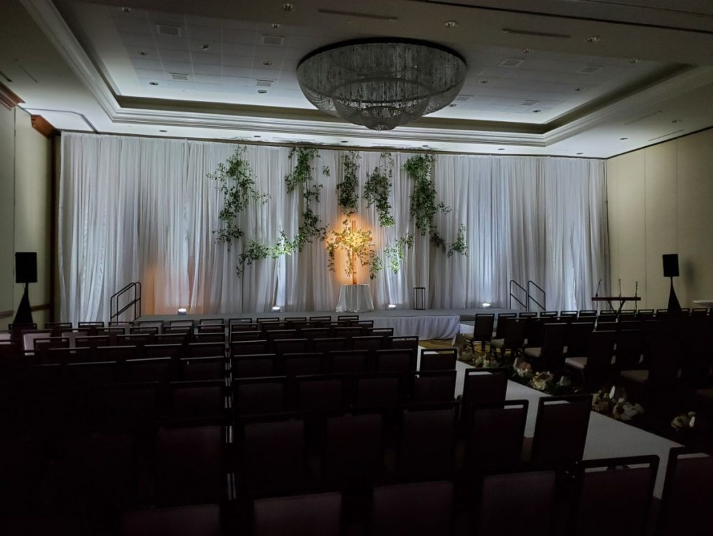 White Sheer Pipe & Drape with White Uplights at Ceremony