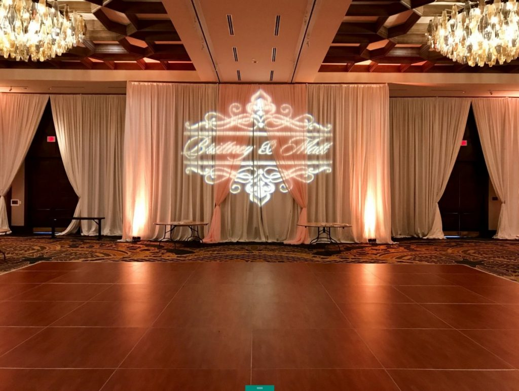 White Pipe & Drape with Blush Accents and Uplights
