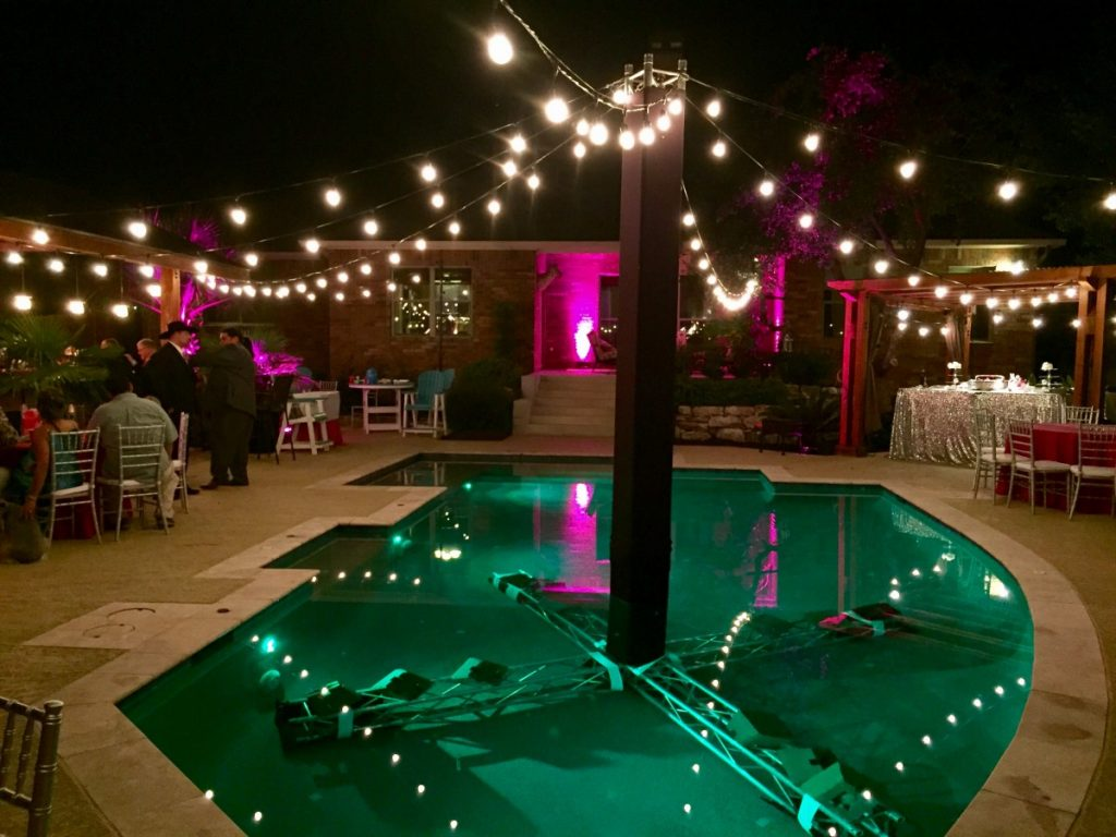 String Lighting over Pool with Truss Support