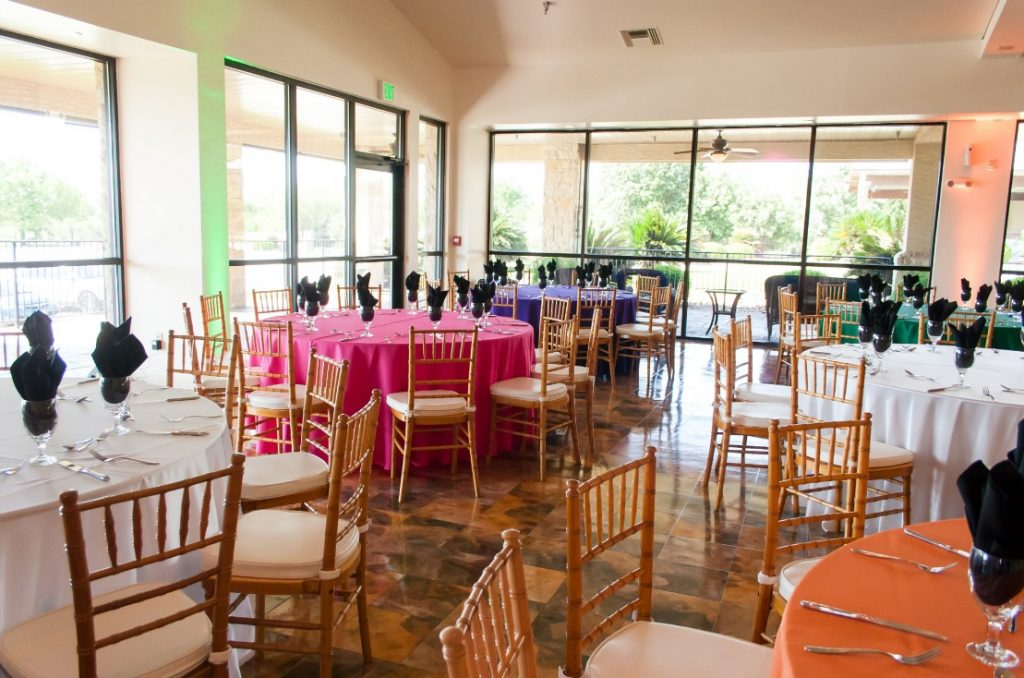 Assorted Color Polyester Linens with Gold Chiavari Chairs
