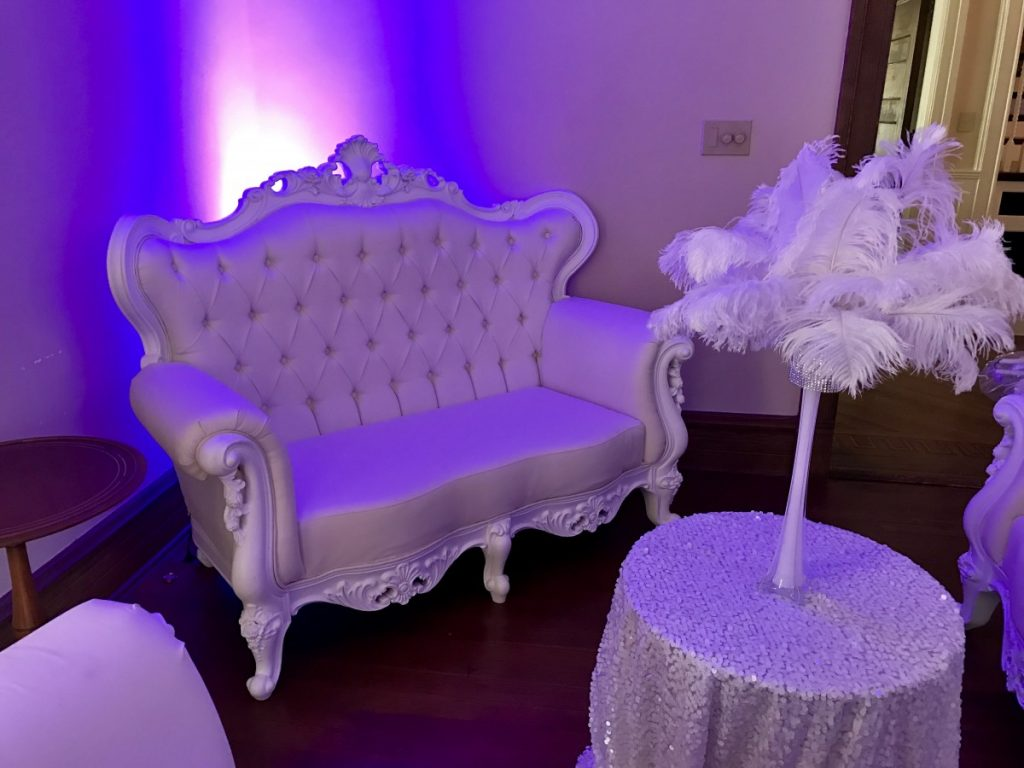 Queen Anne Sofa with Purple Uplighting to Create Effect